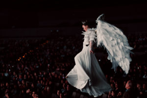 A angel is flying over the crowd, are angels real?